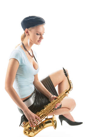 sensual blonde girl in cap dreaming with saxophone isolated over white photo