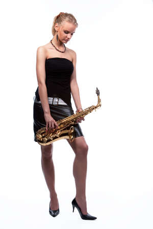 sexy blonde girl dreaming with saxophone isolated on white photo