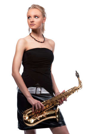 sexy sensual blonde girl dreaming with saxophone isolated on white photo