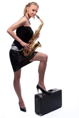 smiling sexy blonde girl standing shaped with sax and suitcase isolated photo