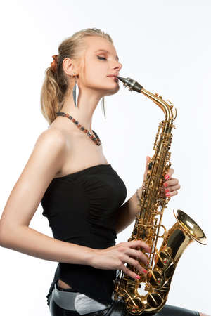 sensual pretty young blonde girl with saxophone isolated photo
