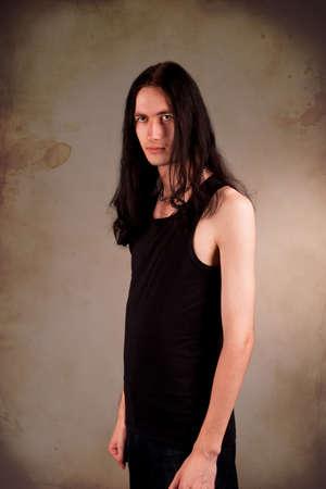 gothic man isolated over grunge background photo