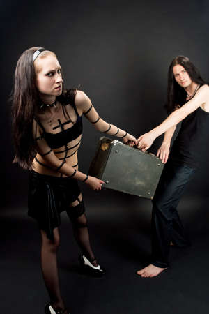sensual extravagant provoking emo gothic couple playing role game photo
