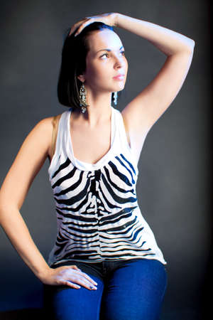 deraming cute caucasian girl with lifted hand sitting isolated photo
