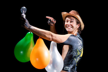 happy handsome cowboy with lamp holding up and baloons pointing  photo