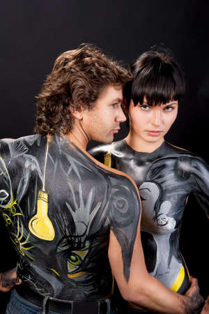 sensual calm caucasian couple with body art together  photo