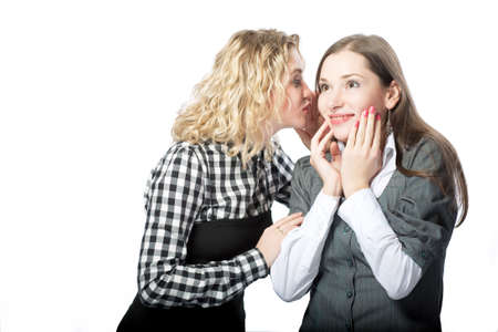 two girlfriends sharing secrets with each other isolated