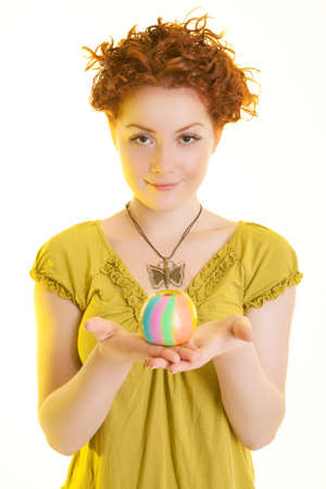 sincere girl: red haired caucasian girl standing symmetrically and holding colored apple on palms and smiling with sincere smile isolated on pure white background