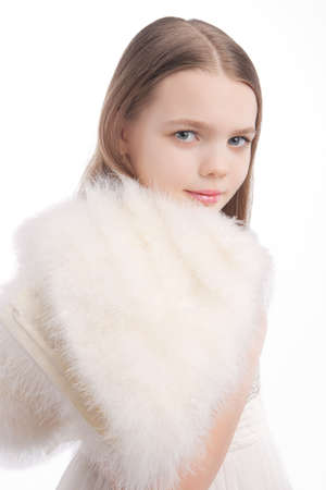age 10 12 years: closeup portrait of young blond little girl standing isolated on white background Stock Photo