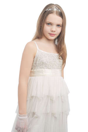 age 10 12 years: young cute female blond kid in white dress wearing artistic crown isolated