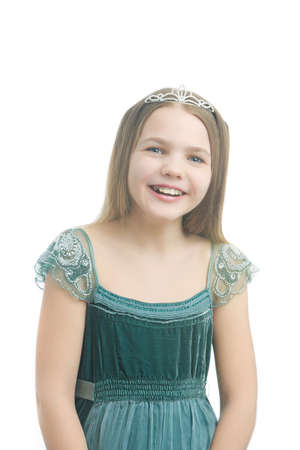 age 10 12 years: young little kid in long dress wearing artistic crown and isolated over white background