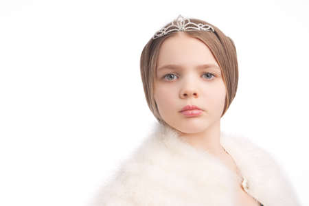 closeup of young blond little girl seusly looking and wearing crown and white fur scarf,isolated Stock Photo - 9883496