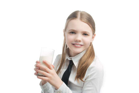 hair tie: little blond caucasian girl drinking milk standing with natural smile isolated over white background