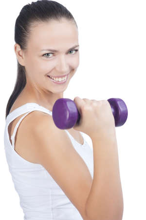 Portrait of fitness woman working  with small weights standing isolated on white Stock Photo