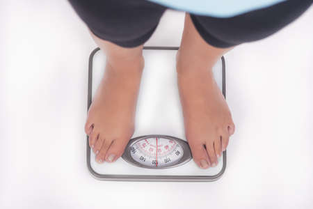 weight scale and woman