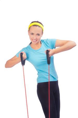 smiling sportswoman standing with red ropes isolated photo