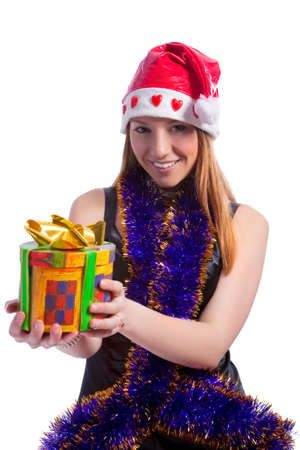 positiv: happy and positiv looking caucasian blond girl with christmas gift and wearing xmas cap smiling over white