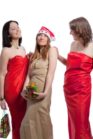 whote: three caucasian sensual girlfriends in christmas closing communicating together and holding gift box in front isolated over whote