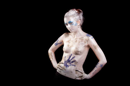 sensual young caucasian girl with body-art painting standing with hands put on hips photo