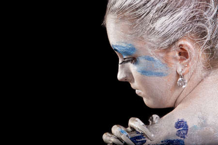 nailart: close-up profile of caucasian young woman with acrylic paint on body, hair and  face, with long nails painted using nail-art technique Stock Photo