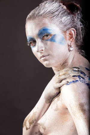 caucasian young woman with acrylic paint on body, hair and  face Stock Photo - 12155401