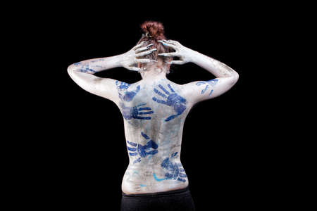 caucasian young woman with body art painting isolated over black photo