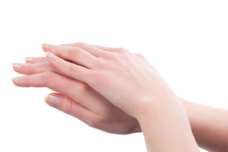 woman  hand: folded hands with perfect skin of young caucasian girl over white