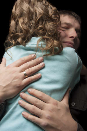 father and daugther standing and embracing over black background Stock Photo - 13522841
