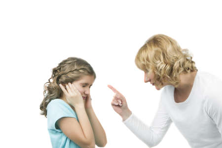 mother instructs her teenage daughter by threatening with a finger standing against white background photo