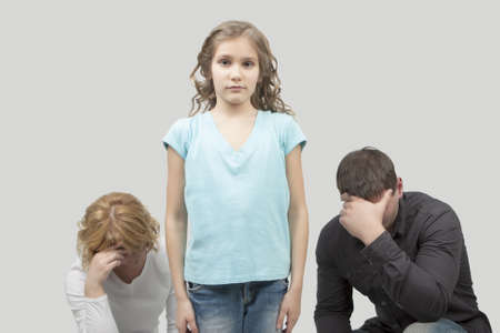 father and mother misunderstand their teenage girl standing separated from each other needed support and dialog isolated over white background photo