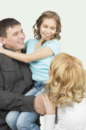 three young caucasian family members together in one accord standing with pleasing attitude and embracing each other with sincere smile Stock Photo - 13522811