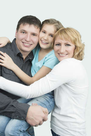 three young caucasian family members together in one accord standing with pleasing attitude and embracing each other with sincere smile Stock Photo - 13522815