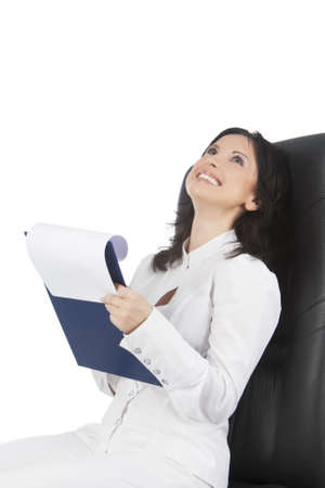 young caucasian businesswoman sitting in black chair with a briliant natural smile isolated over white background photo