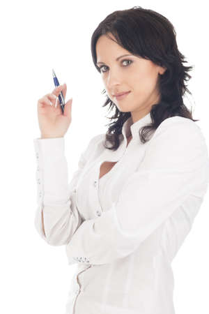 portrait of serious businesswoman in white holding pen in front of her face and isolated on white background photo