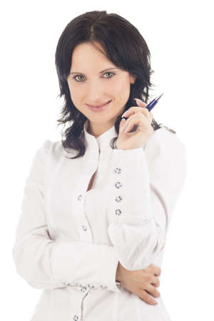businesswoman  in white holding pen in front of her face and smiling and isolated on white background photo