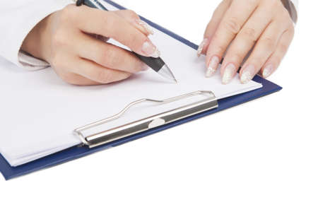 hand of female writing on sheet of paper laying on table isolated on white