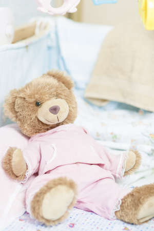 lullaby: toy teddy bear in a cradle for a newborn infant Stock Photo