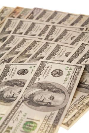 plenty of us dollars laid on white surface alongside Stock Photo - 15511717