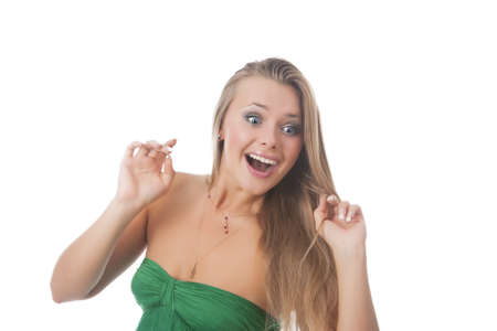 lifted hands: portrait of happy exclaiming sexy blond girl smiling against pure white background
