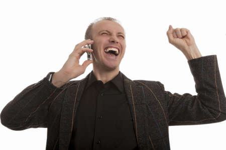 exclaiming: exclaiming young man speaking on cellphone and looking against white background
