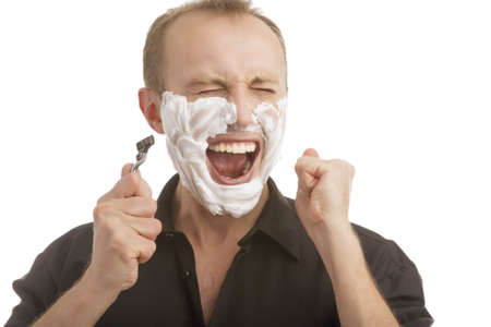 exclaiming: man exclaming while having a shaving process standing isolated over white background Stock Photo