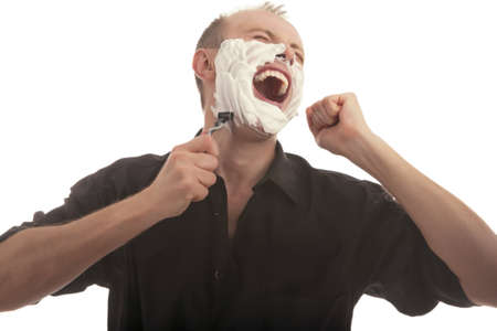 exclaiming: man having a painful shaving over white background Stock Photo