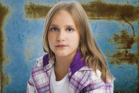 10 12 years: portraif of young caucasian girl isolated over artistic background