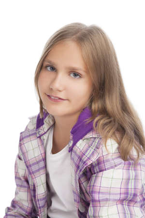 10 years girls: portrait of young little caucasian girl standing over white background