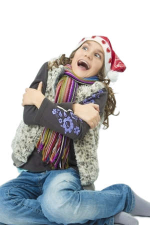 portrait of little caucasian girl laughing and getting frozen over white backgtound Stock Photo - 17106787