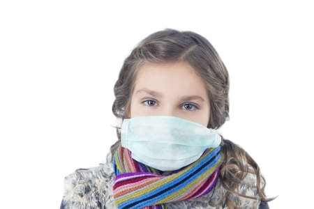 10 to 12 years: portrait of young caucasian girl wearing facial mask and getting frozen Stock Photo