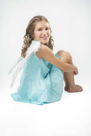 cute lovely portrait of angel girl sitting over white background Stock Photo - 17041563