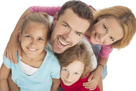 portrait of young happy caucasian family together over white background photo
