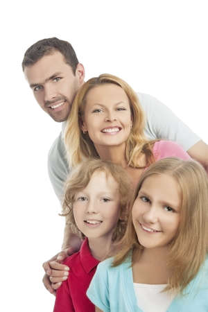 group of four people standing together and smiling over white background, vertical shot