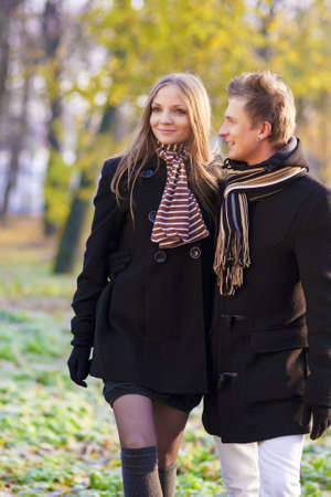 portrait of young caucasian couple having a stroll outside and enjoying photo